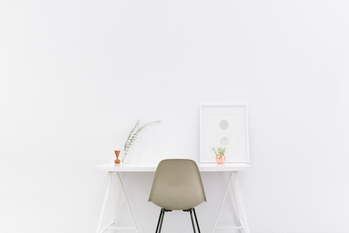 white-table and chair in white room